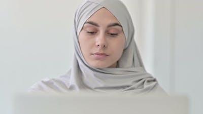Arab Woman Working on Laptop