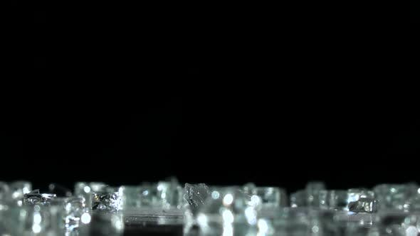 Thumbnail for Shards of Glass Fall To the Floor. Black Background. Slow Motion