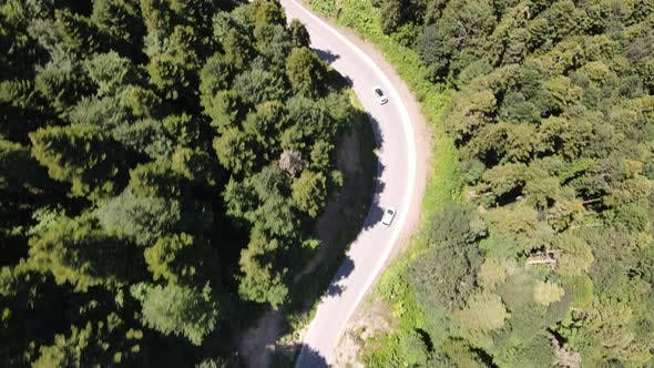 Thumbnail for Drone Moves Along Highway in Rural Area