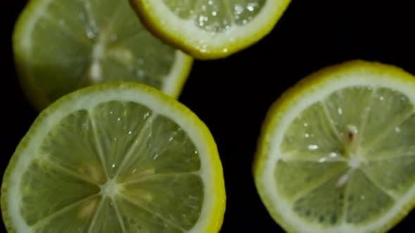 Thumbnail for Round Slices of Lemon on Dark Background
