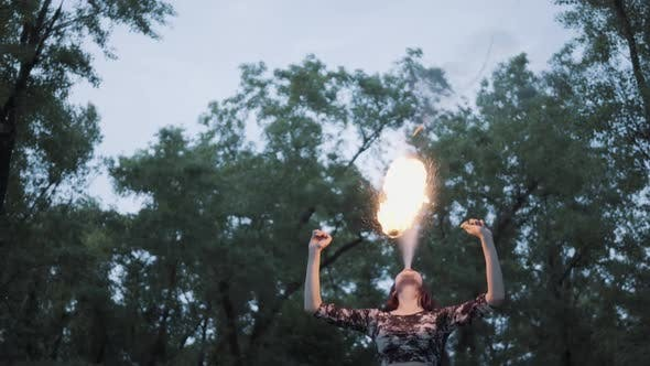 Thumbnail for Portrait Cute Confident Woman Performing a Show with Flame Standing in the Forest or Park