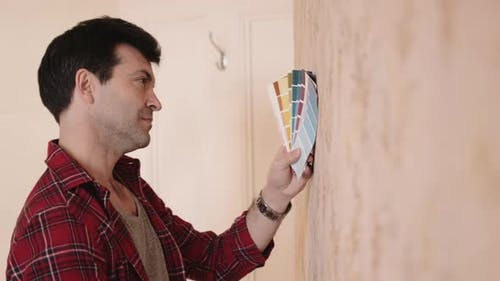 Adult Male picking colours for home interior