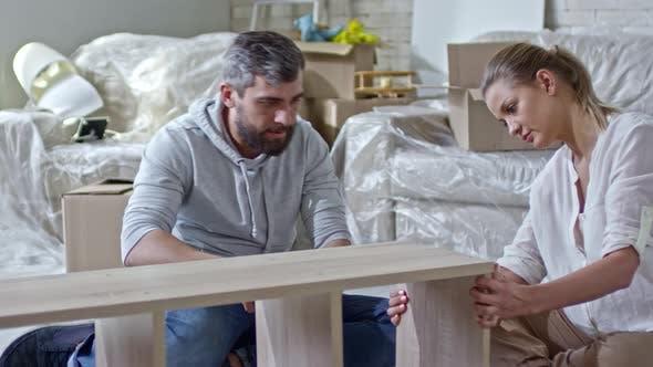 Thumbnail for Married Couple Assembling Shelf