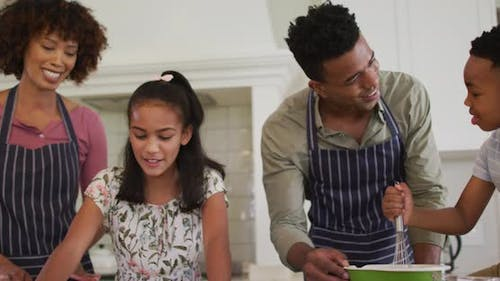 African american family baking together in the kitchen at home