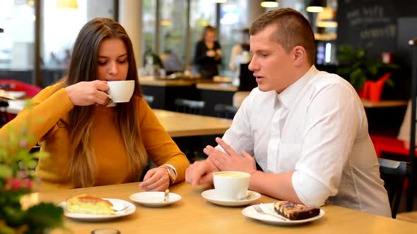 Thumbnail for Happy Couple, Man and Woman, Drink Coffee in Cafe