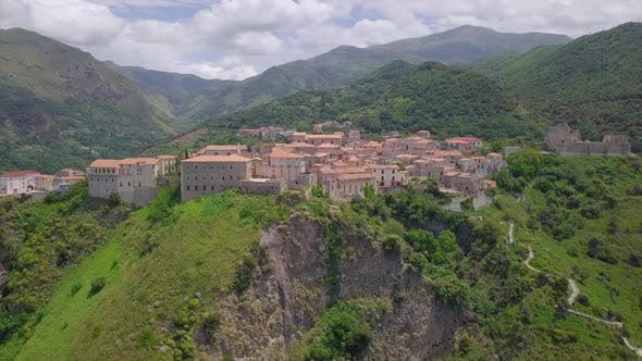 Cover Image for Aerial Medieval Village on Cliff Overlooking Mountain Gorge, Old Town Buildings with Red Tile Roofs