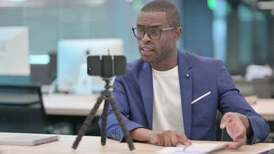 African Businessman Recording Video On Camera