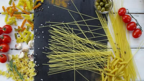Thumbnail for Bunch of Spaghetti Being Thrown on Kitchen Table