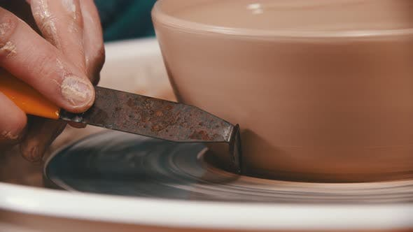 Thumbnail for Pottery - the Master Is Helping Himself To Remove Excess Clay with a Special Modeling Tool in the