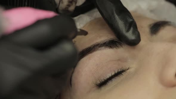 Thumbnail for Microblading Procedure. Master Cosmetologist Draws and Notes with Eyebrow Pencil the Customer for