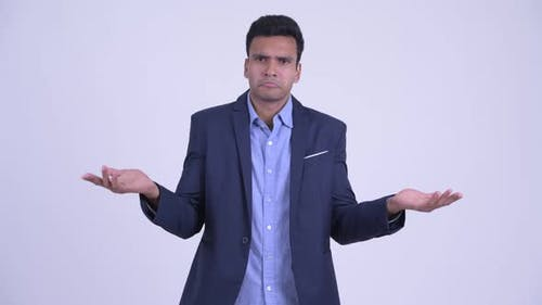 Confused Young Indian Businessman Shrugging Shoulders