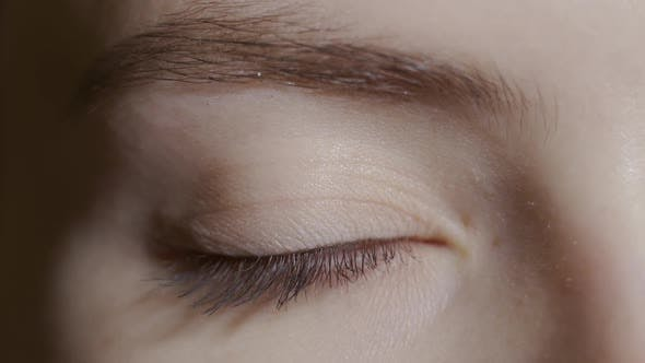 Thumbnail for A Close Up Portrait of a Beauty Young Beautiful Woman's Eyes, Smiling Looking at Camera