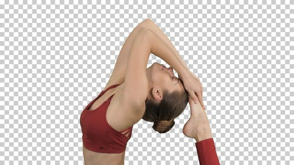 Cover Image for Beautiful young woman doing yoga exercise Eka Pada Rajakapotasana