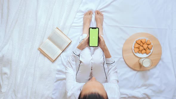 Thumbnail for Above View Caucasian Woman Using Mobile Spend Time in Bed