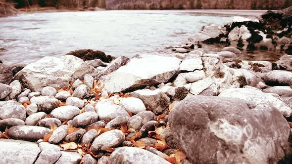 Thumbnail for Dolly Slider Shot of the Splashing Water in a Mountain River Near Forest