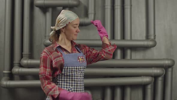 Thumbnail for Housewife in Rubber Gloves Showing Muscular Strength