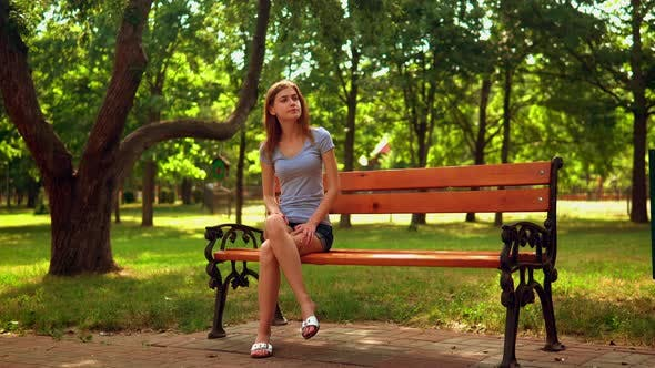 Woman Waiting for Friend in Park