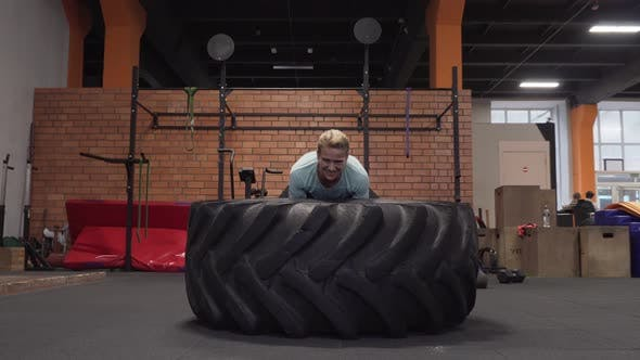 Thumbnail for Fitness Woman Doing Big Tire Flips Workout at Gym