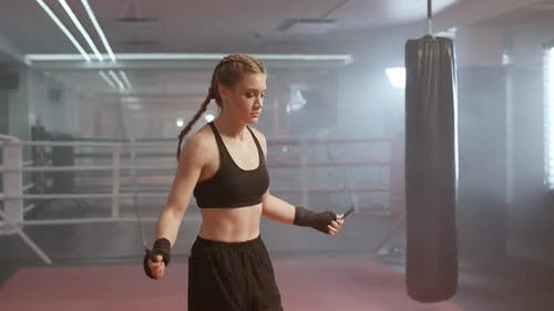 Woman Fighter Trains and Jumping Rope, Coordination Training, Kickboxing Training Day in the Boxing
