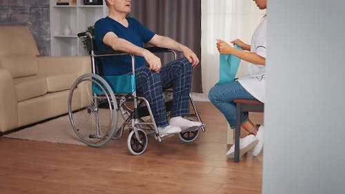 Disabled Senior Patient Working Out