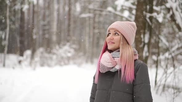 Thumbnail for Slow Motion, Winter Woman in the Woods Watching the Snow Fall and Smiling Looking at the Sky and