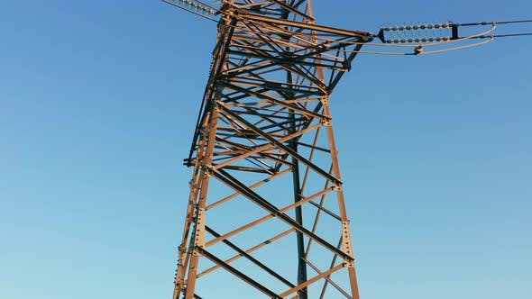 Transmission tower supporting an overhead high voltage power line - close up