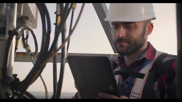 Engineer Working on a Cellular Tower