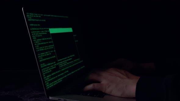 Hands Hacker Using Laptop Computer Hacking In The Dark Room