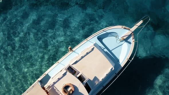 Beautiful White Yacht Moored in a Blue Ocean Lagoon