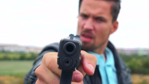 Thumbnail for A Criminal Points a Gun at the Camera and Shouts