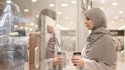 Beautiful Muslim Woman Is on Shopping