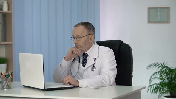 Thumbnail for Head Physician Carefully Studying Medical Records of Patients at Clinic Office