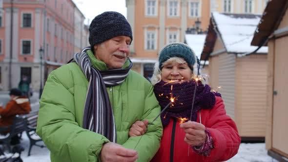 Thumbnail for Elderly Family Holding Bengal Lights Enjoying Christmas Eve Celebrating Birthday on City Street