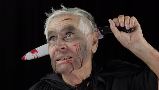 Thumbnail for Elderly Man with Knife in Head. Halloween Makeup and Costume. Blood on His Face