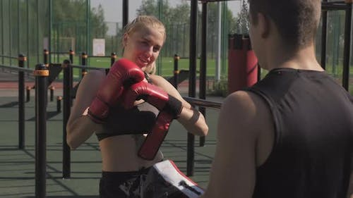 Sport Couple Putting On Boxing Gloves