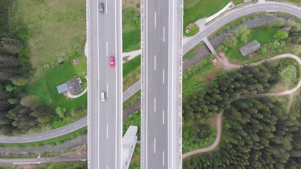Thumbnail for Aerial Top View of Highway Viaduct with Multilane Traffic in Mountains. Autobahn in Austria