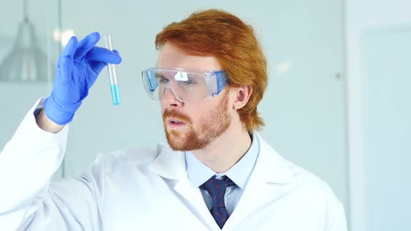 Thumbnail for Scientist, Doctor Looking at Blue Solution in Test Tube in Laboratory