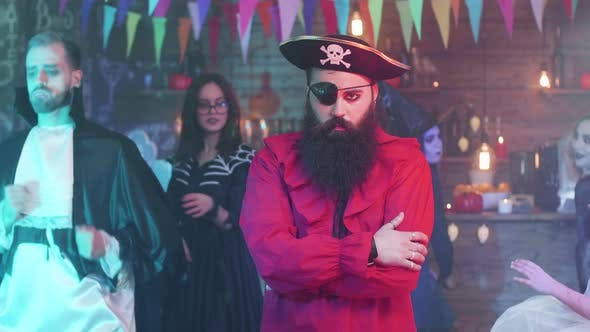 Thumbnail for Portrait of a Handsome Bearded Man in Pirate Costume at a Halloween Party