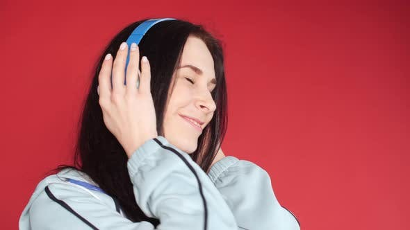 Thumbnail for Happy Young Girl in Sportswear Listening To Music
