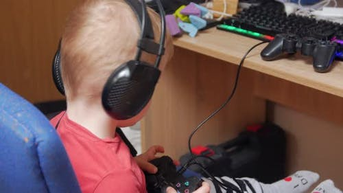 Boy Playing With Joystick