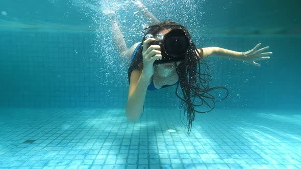 Thumbnail for Travelling Girl in Asia. Happy Young Woman with Beautiful Long Hair Swim Under Water with Camera in