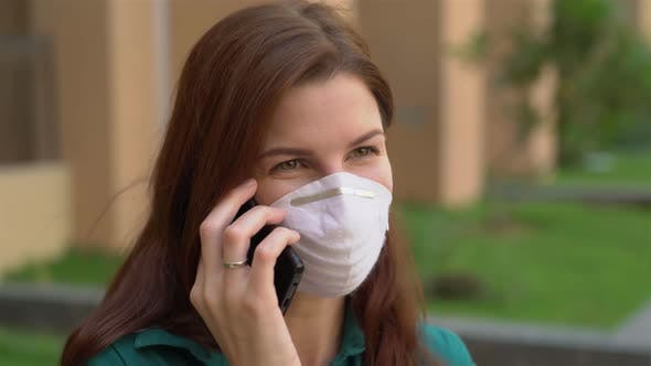 Thumbnail for Girl in a Medical Mask Talking on the Phone