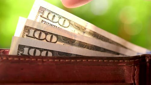 Fingers Recalculating Bank Notes Ben Franklin with Sign 100 $