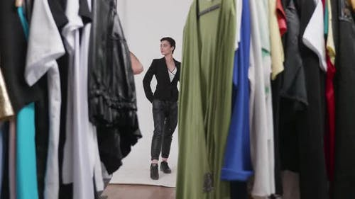 Shooting Through a Rack of Clothes Ready for the Photo Shoot