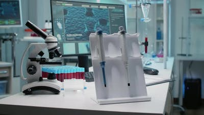 Close Up of Scientific Micropipette and Instruments