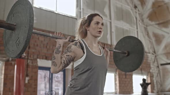 Thumbnail for Female Weightlifter Squatting with Barbell