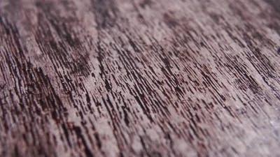 Textured wood material illuminated by moving light