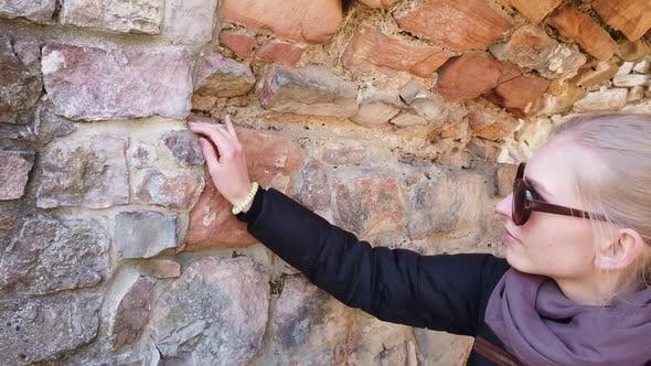 Thumbnail for Girl Inspecting the Walls of an Old Castle in Europe