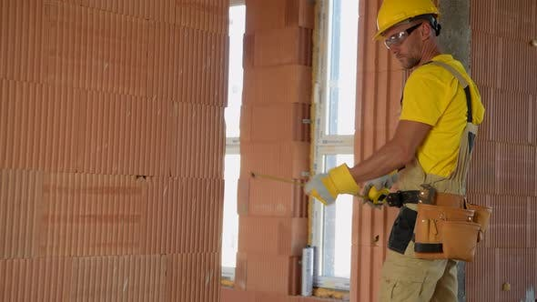 Construction Builder Worker Working Inside Newly Constructed Building