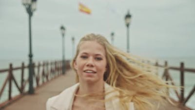 Dancer Performing To Camera On Pier